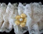 Holiday wedding Vintage lace Brides garter Wedding tradition Eggshell color Vintage ribbon trim Antique brooch embellishemnt
