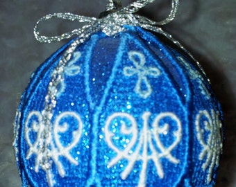 Lace embroidered over a blue glitter ball ornament