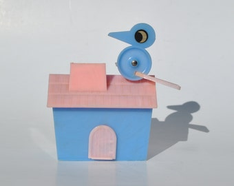 Vintage baby bank house with bird 1950s pink and blue cottage bluebird