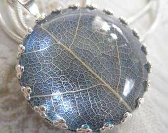 White Skeleton Leaf Under Glass Atop Glowing Royal Blue Crown Pendant-Nature's Art-Symbolizes Peace Tranquility, Serenity-Gifts Under 25