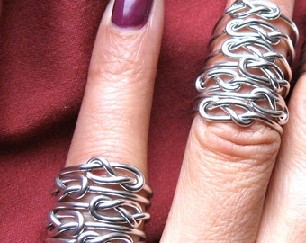 six sterling silver  INFINITY RINGS