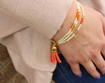 Orange Layered Beaded Tassel Bracelet.