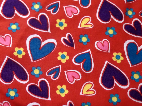 Kids cotton knit fabric hearts in blue purple pink on red for Kids knit fabric