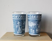 Vintage Souvenir Montreal Drinking Glasses Slate Blue With Graphics of Landmarks.