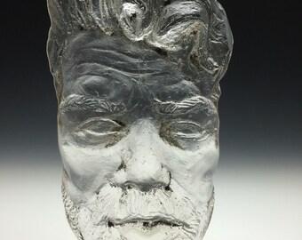 Cast glass sculpture, face of a man singing, sand cast portrait art mask