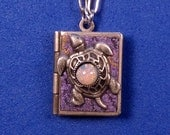 Turtle Love Locket- purple and silver, holding 14 ways to tell someone you love them, from English to American Sign Language.