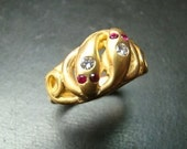 Beautiful 14k gold double snake ring with diamonds and rubies