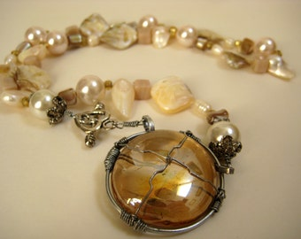Pearl necklace with glass pendant, wirewrapped amber glass pendant