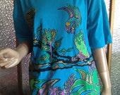 Turquoise Glitter Parrot Scene T Shirt