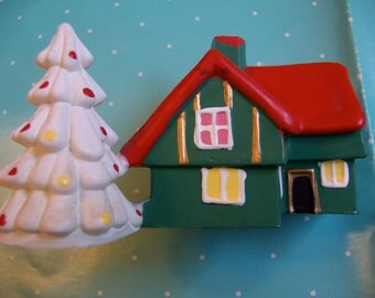 little plastic christmas cottage