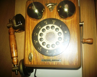Vintage Telephone  14 x 27 wide and tall works great in good condition.