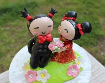 Custom handmade Clay Pucca and Garu Wedding Cake Topper with base