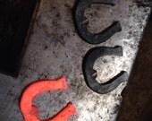 Forged horseshoe bottle openers