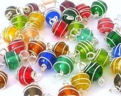 20 spiral wrapped charms or spiral wrapped connectors, multicolored caged glass balls