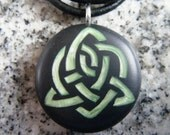 Celtic Symbol For Sisterhood hand carved on a polymer clay black color background.  Pendant comes with a FREE necklace.