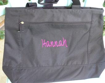 Eleven monogrammed zippered totes