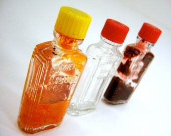 3 small glass bottles, Art Deco vintage 1940s dry food coloring Easter egg dye jars, bakelite lid caps yellow red clear art collectibles
