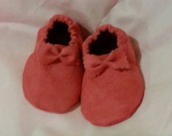 Pink suade baby shoes