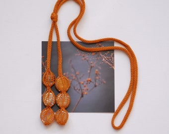 knitted necklace MIPPE, yellow ocher