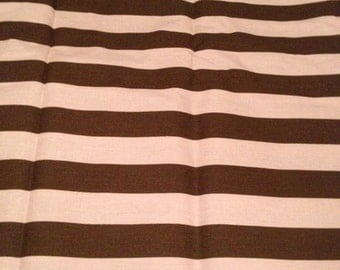 Pink and brown striped home decor weight fabric.