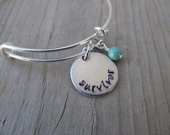 "Survivor Bracelet- Hand-Stamped ""survivor"" Bracelet with an accent bead in your choice of colors"