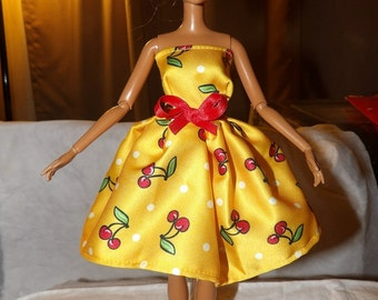 Bright yellow cherry print party dress with red bow sash for Fashion Dolls - ed683