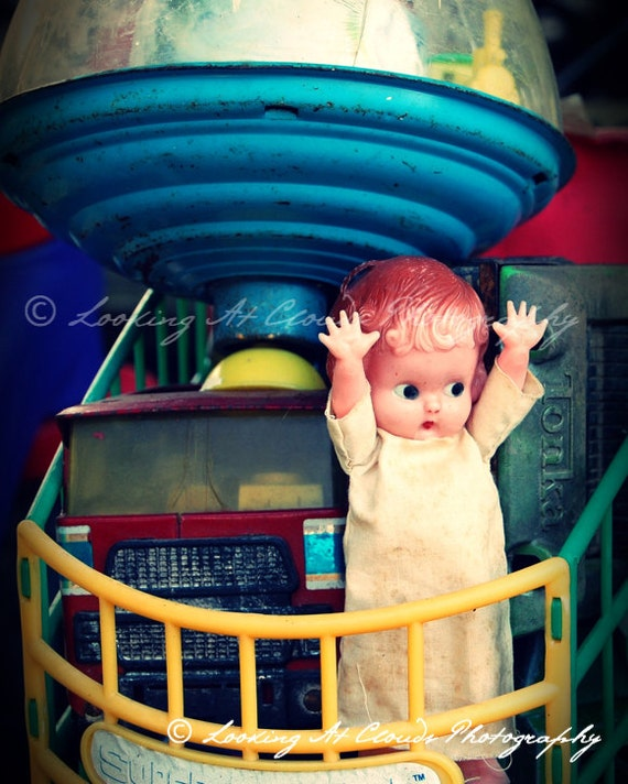cute doll and old toys kitschy art photo, happy kewpie doll and colorful vintage toys, primary colors, nursery decor or for fun