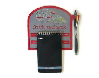 Magnetic notepad holder for camper