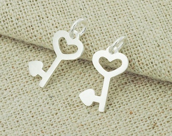 4 of 925 Sterling Silver Heart  Key Charms 8x14 mm. :th1566