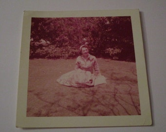 Vtg photo of a woman laying on grass in pretty dress, shadow photo from 1958. Gloria look-a-like from American Horror Story FREAK SHOW