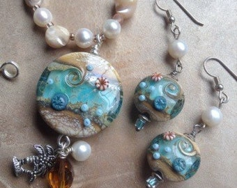 Plage d'eté...lampwork beads, pearls, crystals and sea shell beads necklace and earring set