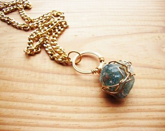 Wire wrapped green calcite on gold plate chain