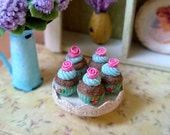 1/12 scale miniature dollhouse pink rose cupcakes on the crackled stand.