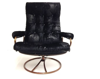 Ekornes 1971 mid century lounge chair with real black leather cowhide.