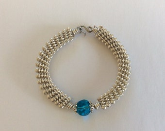 Wire wrapped coil bracelet with Aqua crystal bead/ turquoise crystal bracelet/ silver coil bracelet/ stackable bracelet