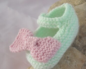 Handknitted Mary Jane style baby shoes 0-3mth  in Mint with an oversized dusky pink bow