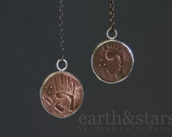 handprint and footprint ancient coin necklace in copper with fine silver bezel