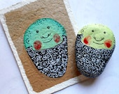 Handpainted stone and recycled gift card