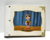 Pinnochio, wood boy, boy scrapbook, disney world, disney scrapbook, memories keepsake, disney figure, parent book, disney album