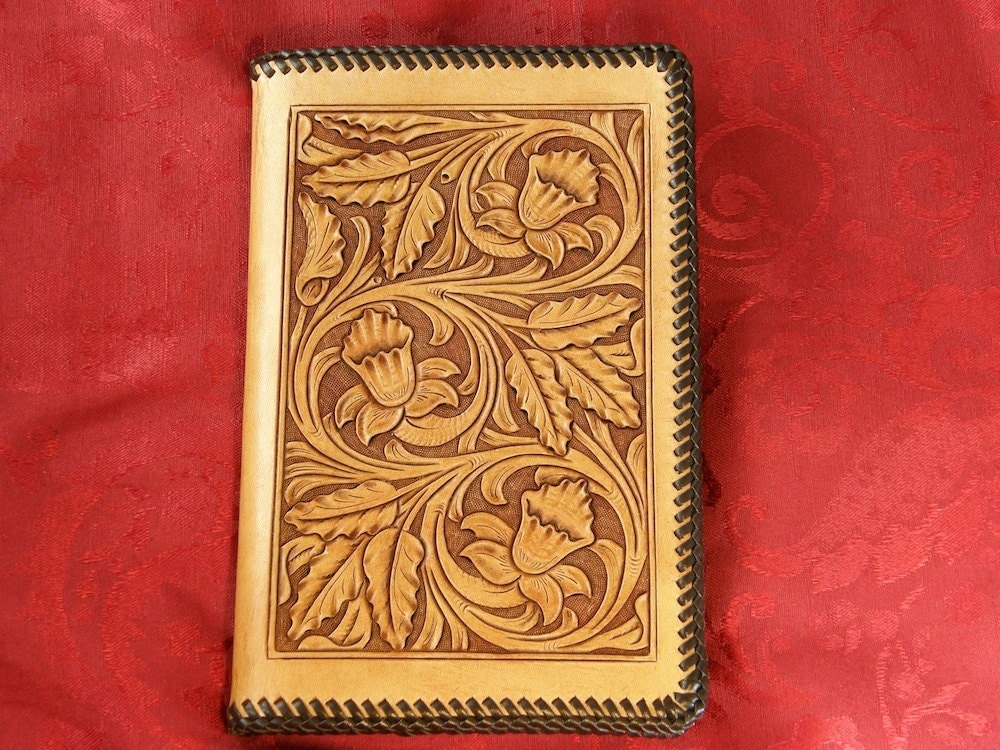 Handmade leather notebook or journal with carved