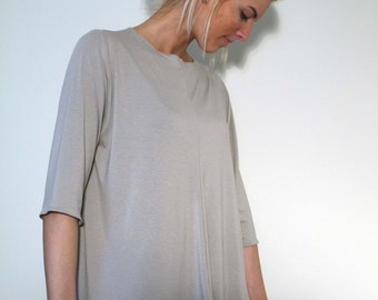 Light Grey Semi Sheer Loose Top with Center Front and Center Back Seam and Mid Sleeves and Uneven Hemline