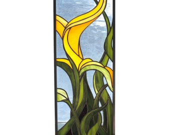 Stained glass panel of plant in yellow blue and green