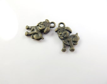 8 antique gold puppy charms