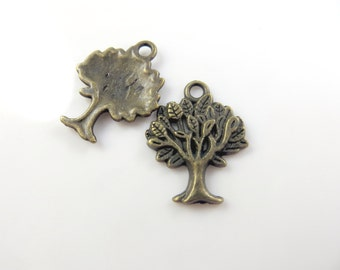 10 antique gold tree charms