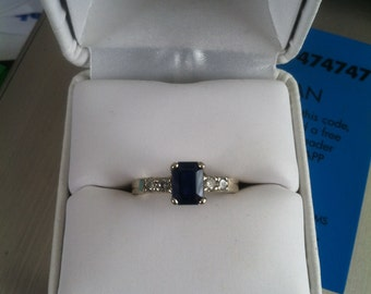 14kt white gold diamond and sapphire ring.
