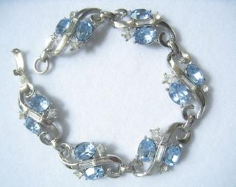 "CLEARANCE Vintage Bracelet. Silver ""S"" Swirl Links hold Blue & Clear Rhinestones in Graceful Design.  7-1/8"" Long."