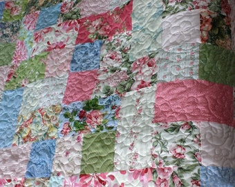 Handmade lap quilt with pink roses and vintage prints