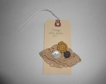 vintage lace and button pin doily