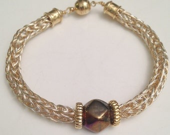 silver and gold viking knit ladies bracelet with dark amythest bead