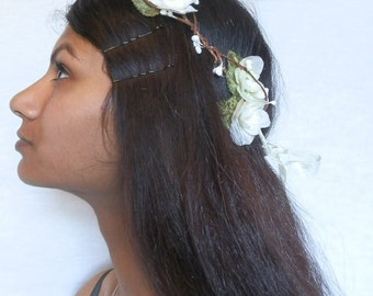 White bridal wedding hairpiece hair crown wreath garland flowers leaves cream white roses floral